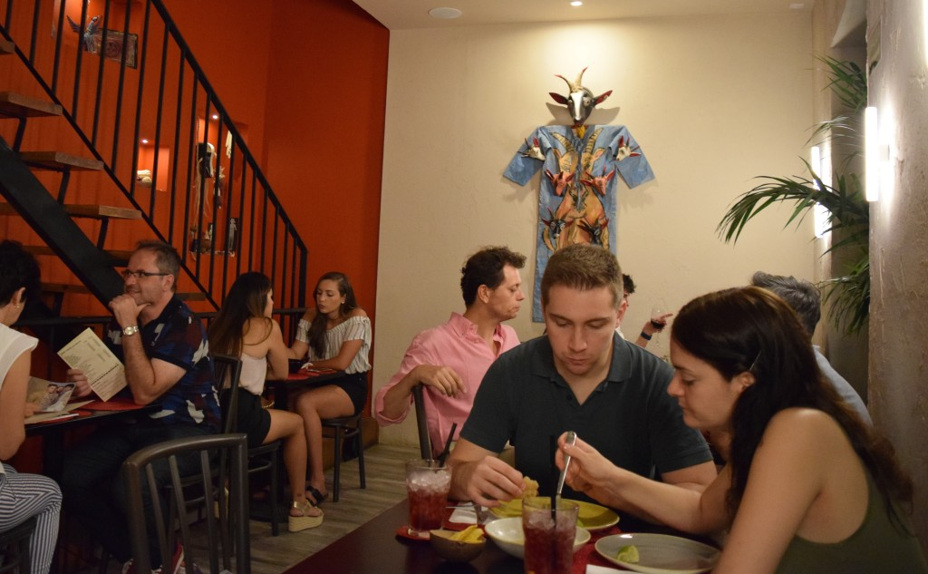 The interior dining area, decorated with indigenous art and bright colors